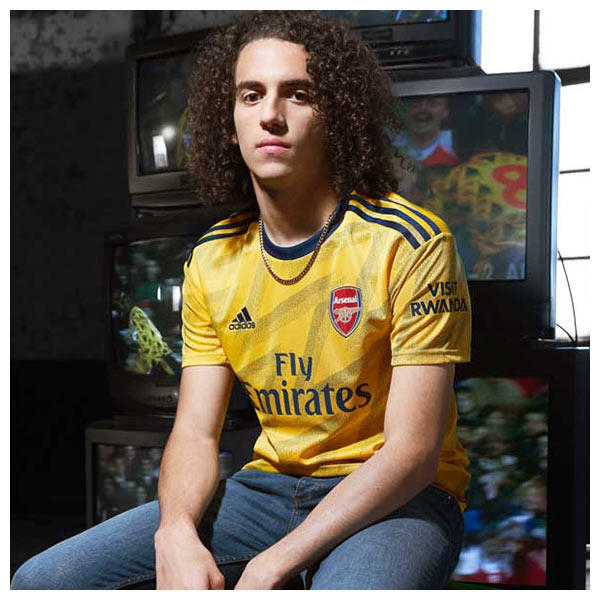 Mattéo Guendouzi wears the 2019-20 Arsenal FC Away Jersey