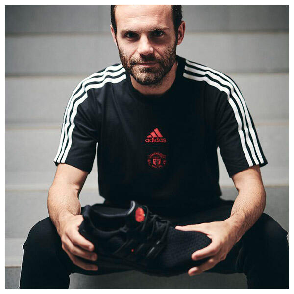 Juan Mata wears the adidas x Manchester United Special Edition RED ROSE UltraBoost Trainer
