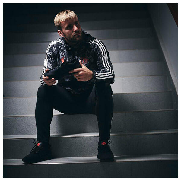 Luke Shaw wears the adidas x Manchester United Special Edition RED ROSE UltraBoost Trainer