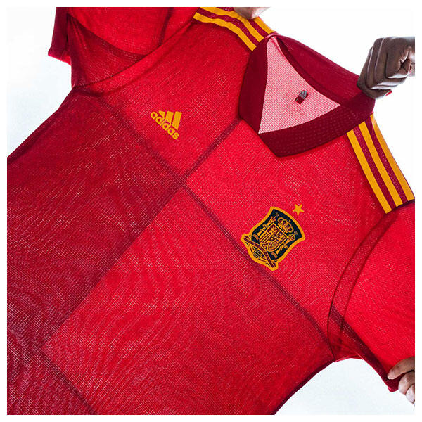 The 2020 Spain Home Jersey from adidas Football features an original hand-painted artwork